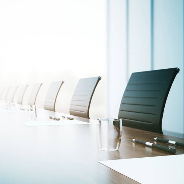 Table and chairs in company boardroom